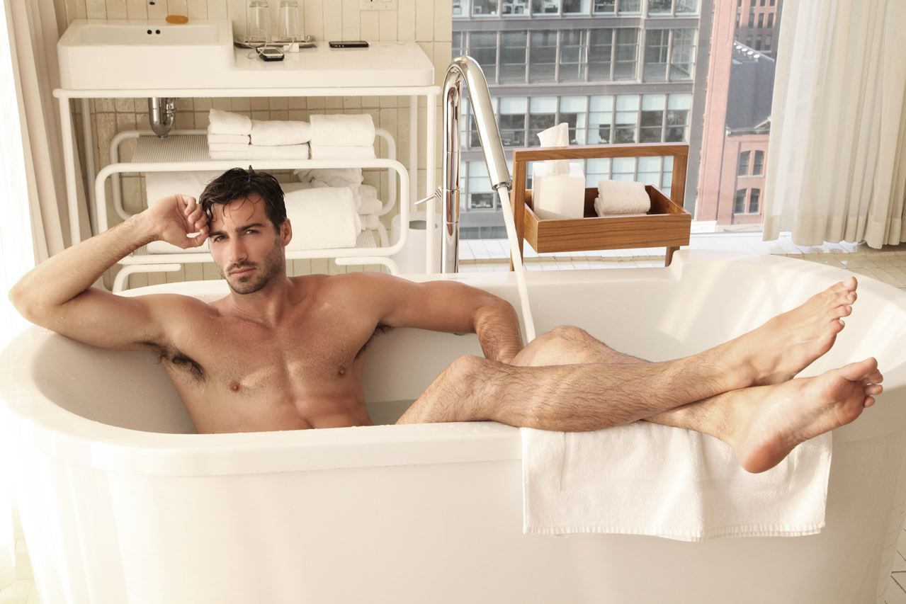 Sexy male models in bathroom